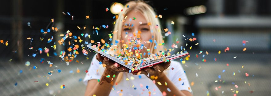 woman with book and confetti