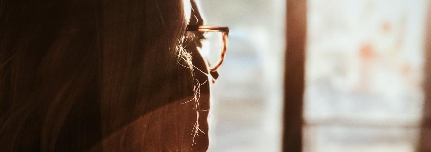 woman looking out door